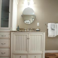 Rustic Vanity With Oval Mirror