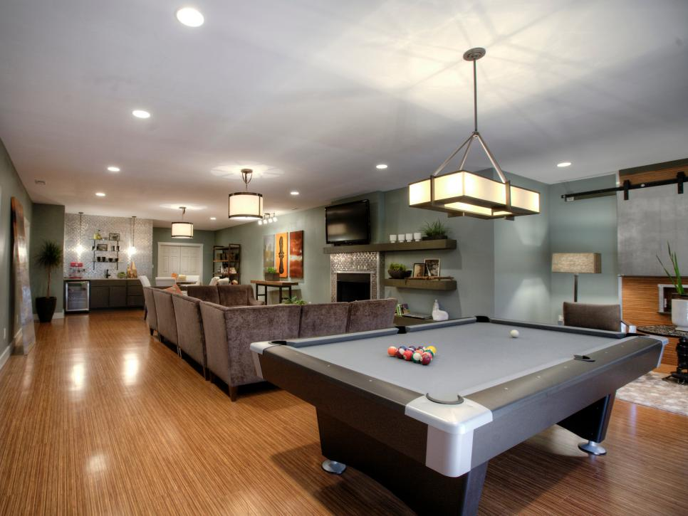 Game Room Design Ideas 6 tags contemporary game room with l shaped couch tanga 5 light hanging chrome island Media Room Design Ideas Hgtv