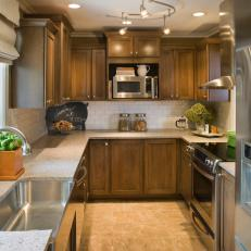 Transitional Galley Kitchen With Brown Cabinets