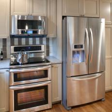Neutral Kitchen Cabinets With Stainless Steel Refrigerator