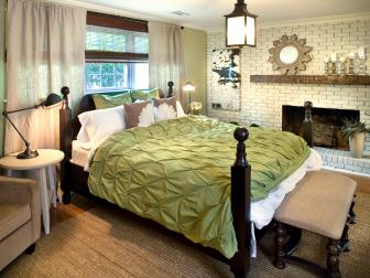 Brick Fireplace in Green Cottage Bedroom