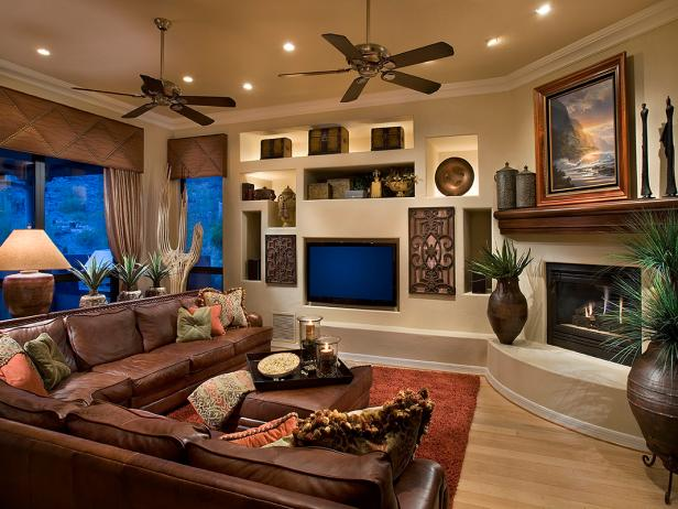 Living Room With Leather Sectional And Fireplace