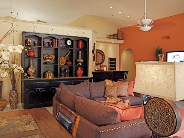 Great Room With Brown Sectional and Black Shelves