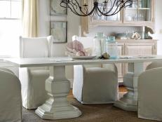 White Coastal Dining Room With White Farmhouse Table