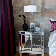 glamorous bedroom with mirrored nightstand and toile