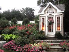 Neutral Garden Shed in Pink Flower Garden with Stone Steps