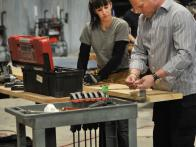 Mike Holmes Working on Project with Contestant