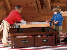 Kids play air hockey