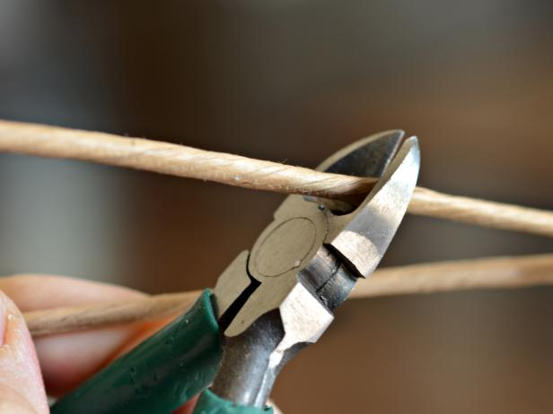 Use wire cutters to clip dried mushroom wire stems to approximately three inches long