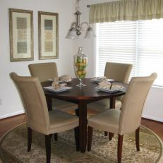 Neutral Transitional Dining Room With Round Table And Area Rug