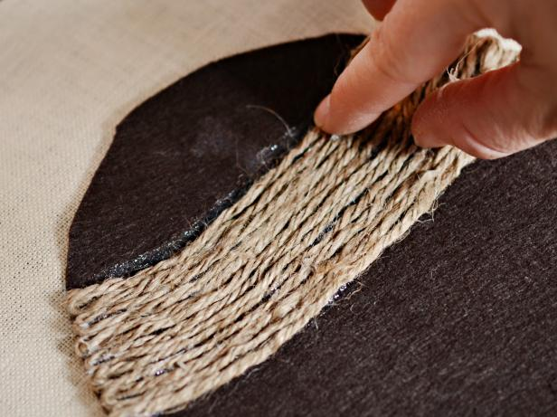 Stick jute twine to hot glue. Hold in place until glue cools. Continue this process, weaving jute twine back and forth until entire cap is covered.