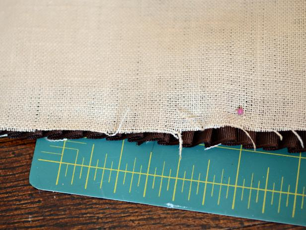With acorn and trim facing up, place second piece of linen on top.