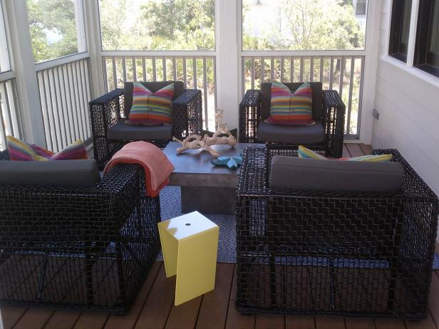Transitional Porch With Black Chairs and Multicolored Pillows