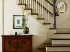 Transitional Foyer With Elegant Staircase