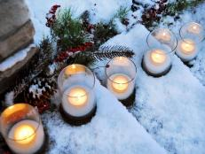 Candles Deliver Warmth to Snowy Steps