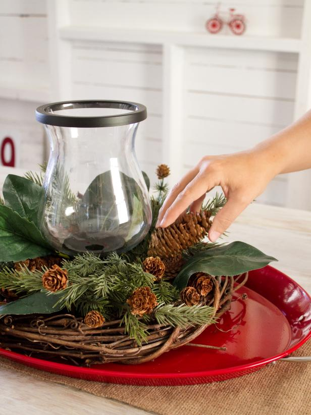 Placing Pine Cones on a Centerpiece Step 3