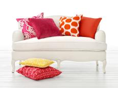 White Sofa With Fuchsia and Orange Accent Pillows