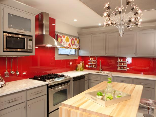 Contemporary Kitchen With Gray Cabinets and Red Backsplash