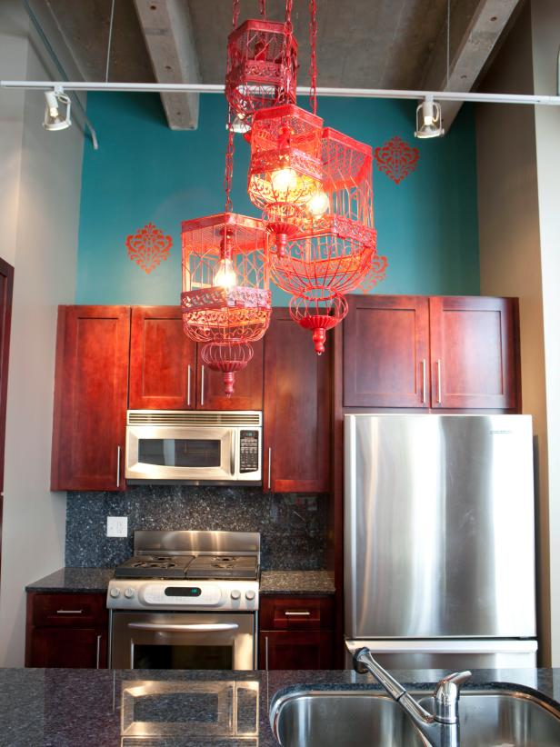 teal kitchen with eclectic chandelier made with red birdcages