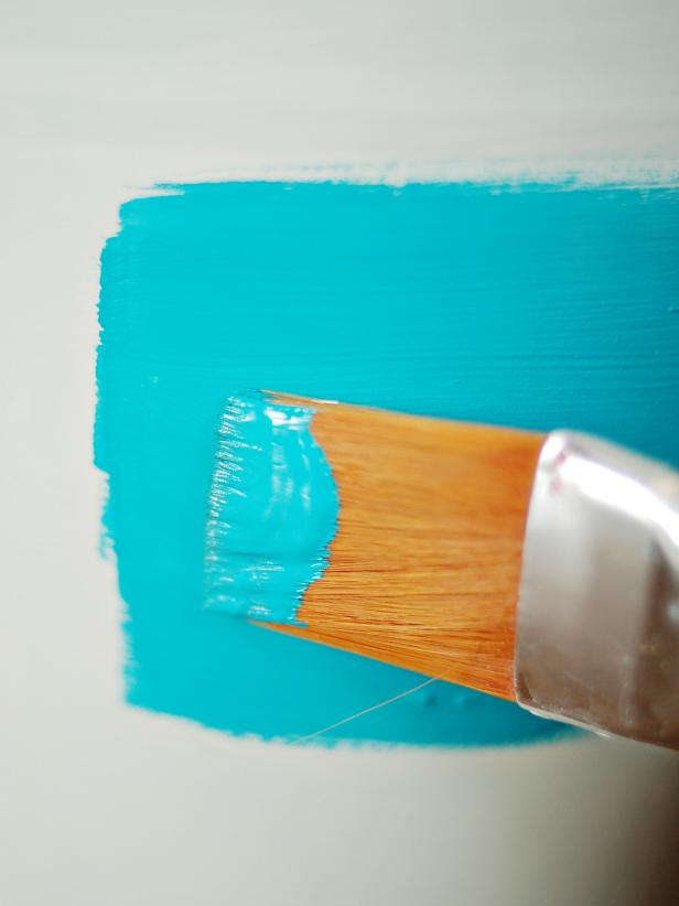 Spray primer onto pails and allow to dry. Apply acrylic paint with one-inch brush to each pail. Use long horizontal strokes to reduce brush marks. Apply second and third coats, if necessary, allowing ample dry time between coats.