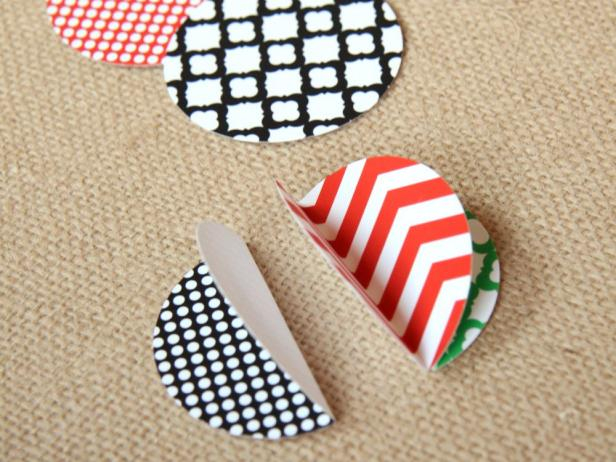 Use double-sided tape to attach three folded circles together back to back.