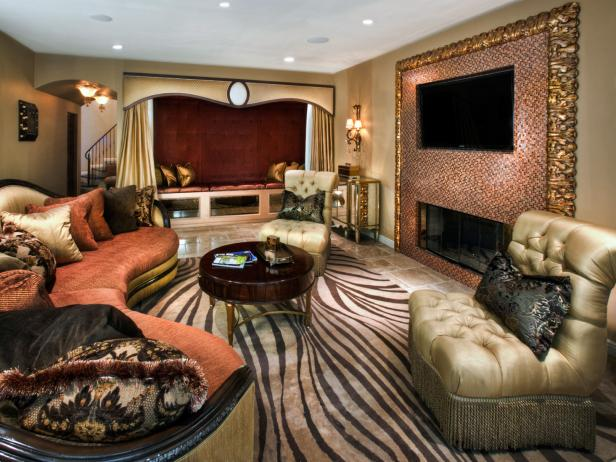 Entertainment Room With Tiled TV Wall, Curvy Sofa and Bold Rug