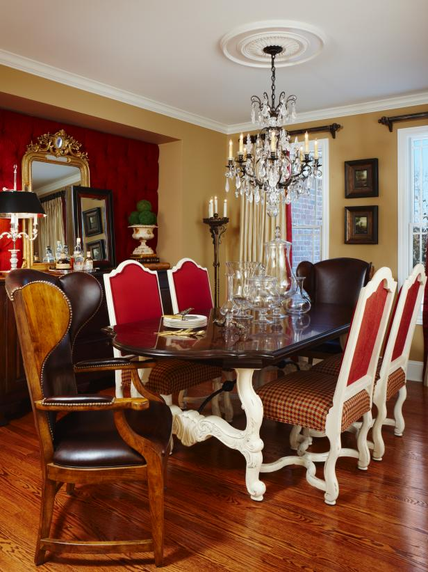 Traditional Red Dining Room With Dining Table and Chandelier
