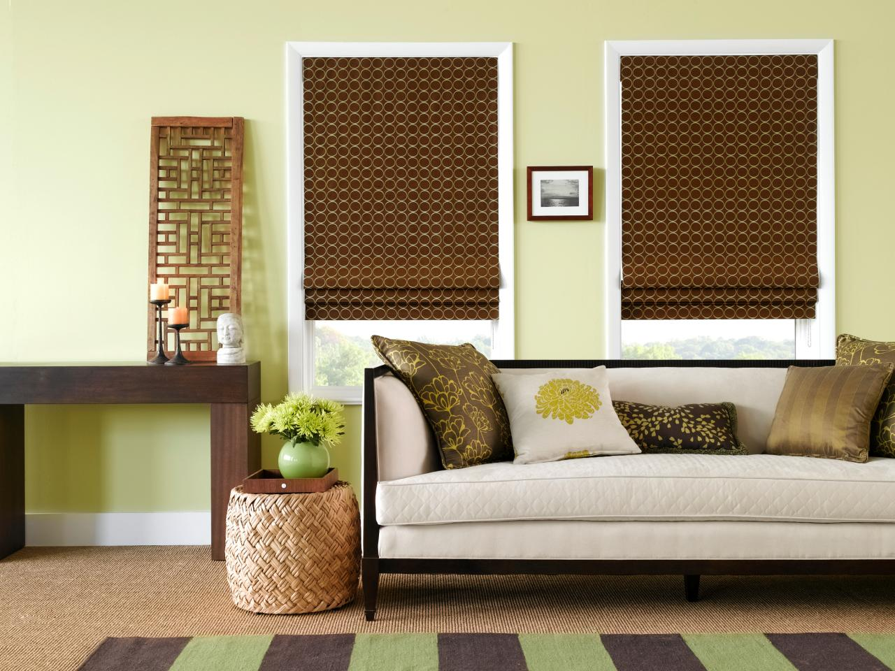 green living room with brown roman shades a pair of roman shades adds