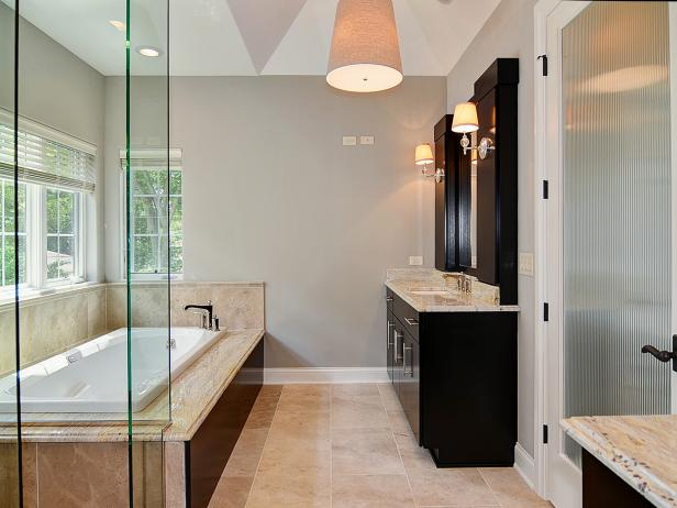 Contemporary Bathroom with Black Cabinets and Alcove Bathtub