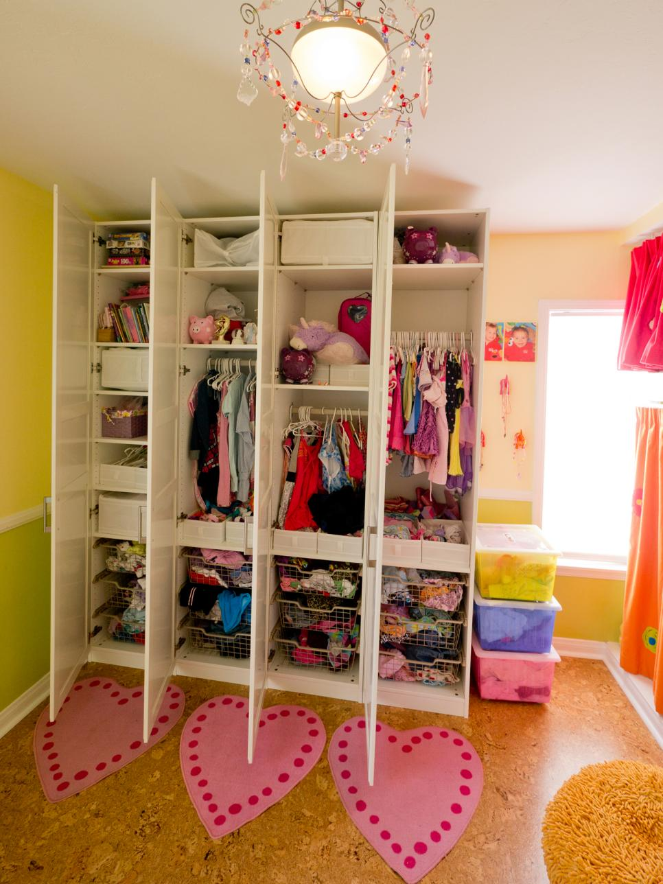 Creative shared bedroom for three girls hgtv for Kids room closet ideas