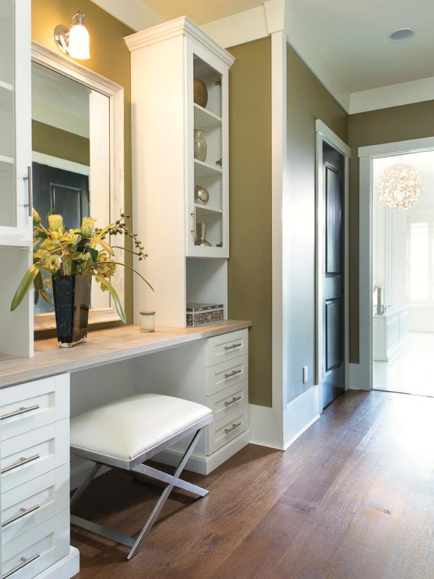 Dressing Area With White Vanity, Wood Countertop and Upholstered Bench