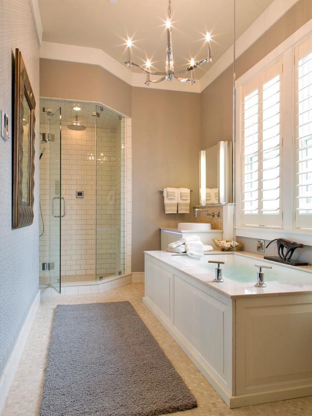 Neutral Bathroom With Contemporary Chandelier and Large Bathtub