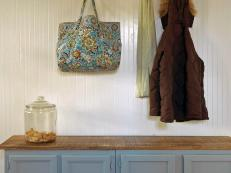 Traditional Mudroom with white bead board and a functional storage bench