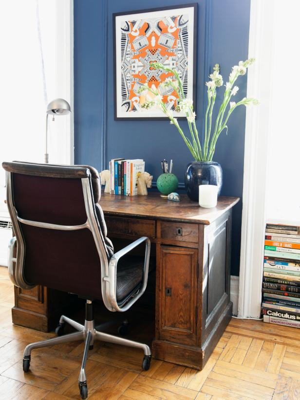 Blue Office Space With Art and Flowers