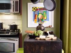 Green Kitchen With Wall-Mounted Reclaimed Wood Table