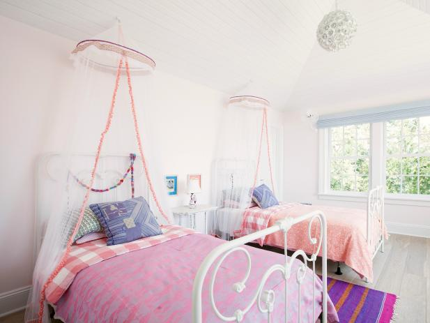 Light Pink Bedroom With White Iron Twin Beds and Sheer Canopies