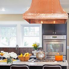 Black Kitchen Cabinets With Copper Range Hood
