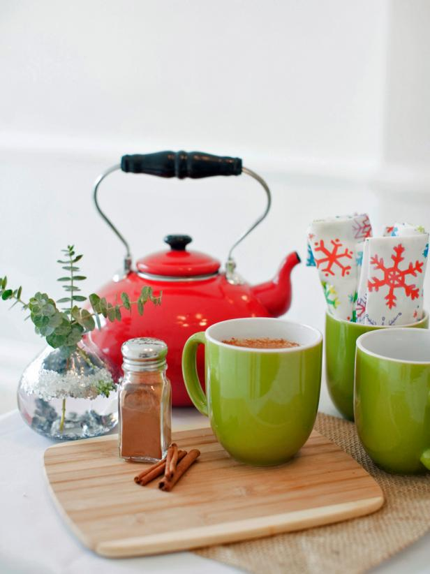 Green Mugs With Cinnamon and Red Teakettle