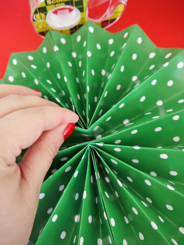 Fold each sheet widthways, and secure with tape. Attach all three pieces together and secure the middle with double-sided tape.