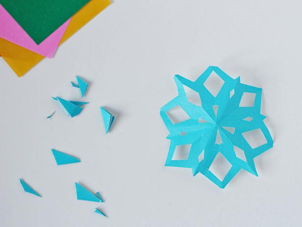 Unfold the snowflake, admire your handiwork and smooth the snowflake to flatten.