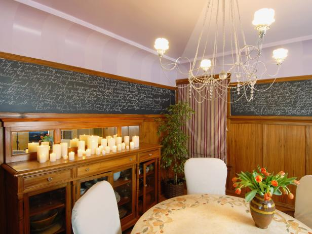 Traditional Dining Room With Chandelier, Wood Paneling and Chalkboard
