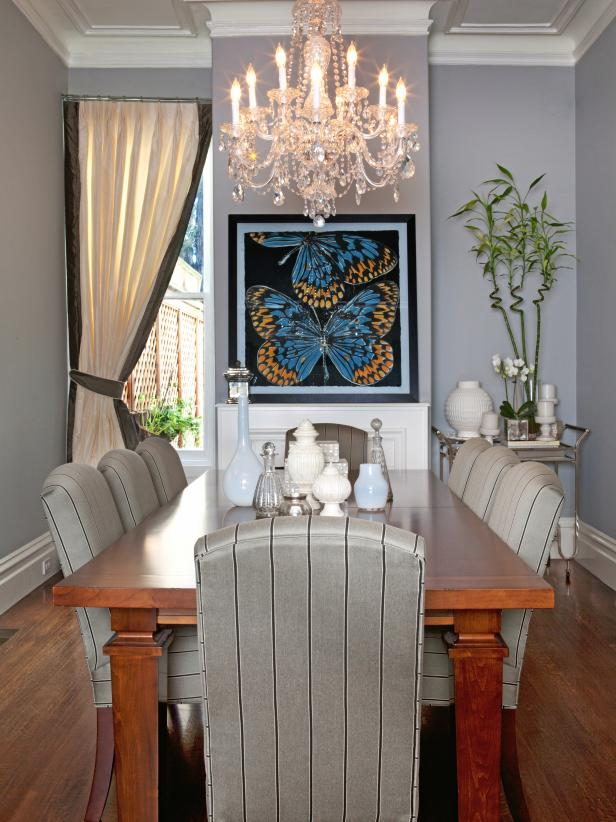 Transitional Gray Dining Room With Crystal Chandelier & Butterfly Art