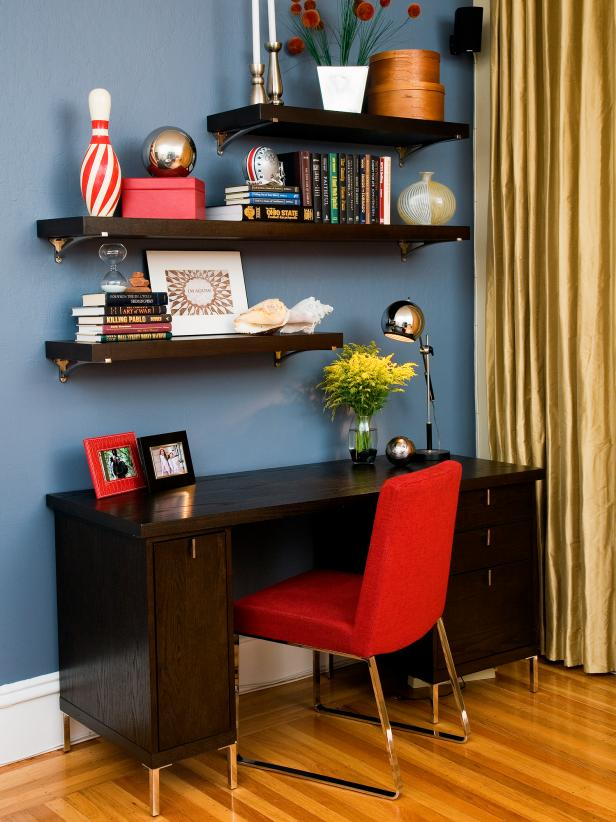 Contemporary Home Office With Floating Shelves and Red Chair