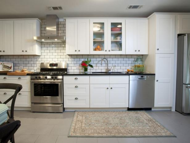 White Transitional Kitchen With Subway Tile Backsplash and Muted Rug