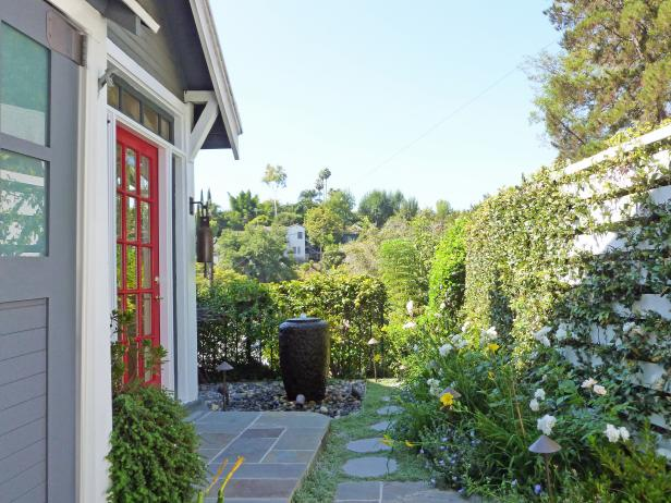 Transitional Outdoor Patio With Red Door and Living Wall