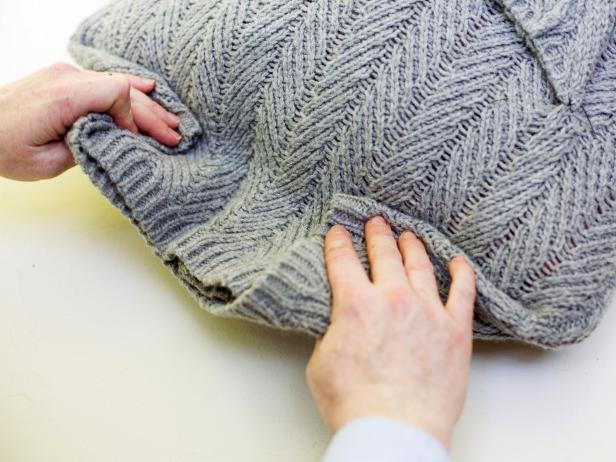 Folding the Bottom of a Sweater to an Insert to Create a Sweater Pillow