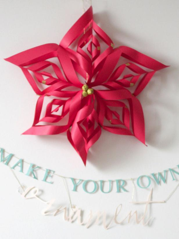 Make a paper snowflake star christmas ornament hgtv for How to make easy christmas decorations at home