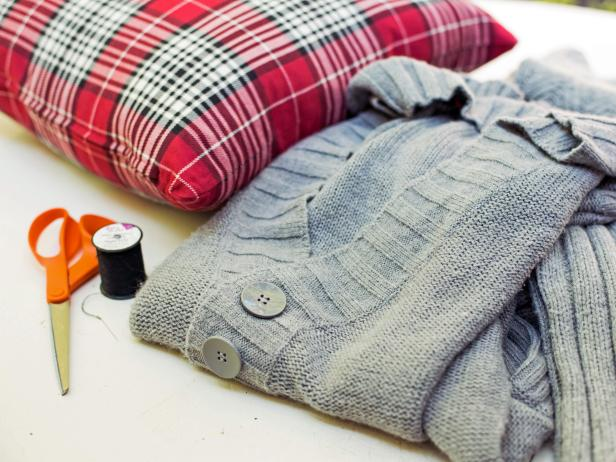 The first step in creating a sweater pillow is to gather the materials you will need to work on the project. You will need an needle and thread, a sweater or man's shirt, and pillow inserts.