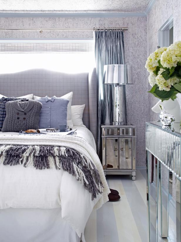 Mirrored Furniture & Menswear Pillows In Blue Bedroom