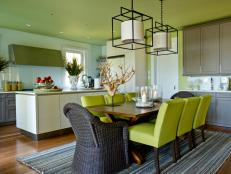 Green and White Contemporary Kitchen and Dining Area